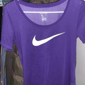 Purple Nike short sleeve dri-fit shirt